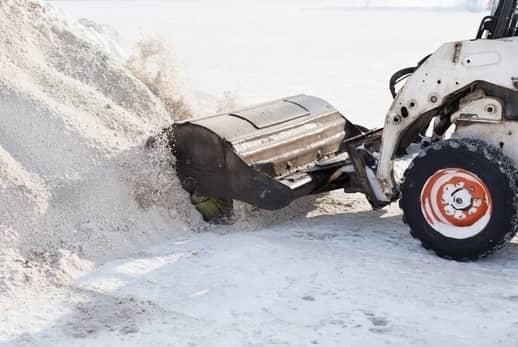 A snow plow working in Grande Prairie.